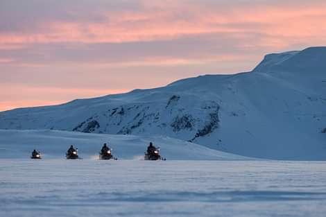 Snowmobiling in Langjökull at Sunset Pink sky