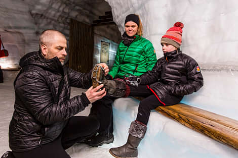 Putting on crampons in the icecave