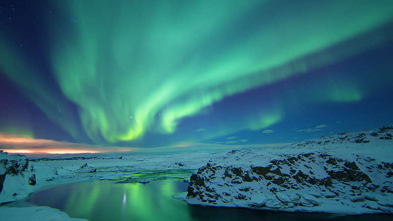 Northern Lights reflecting in water