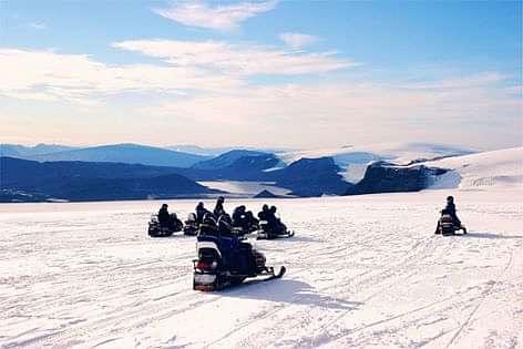 Snowmobiling in Langjökull Glacier in Iceland