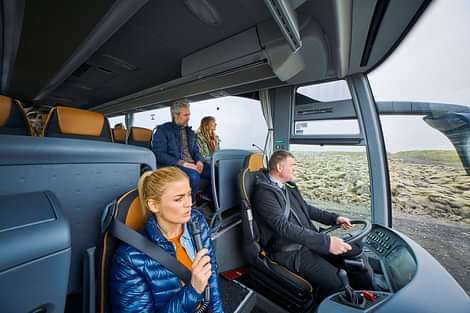 guide talking in tour bus