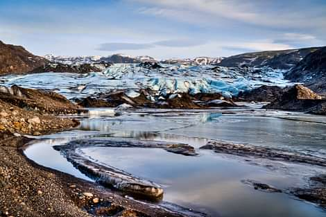 Glacier with water and sand lagoon