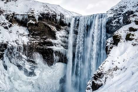 Skogafoss with ice and snow in winter