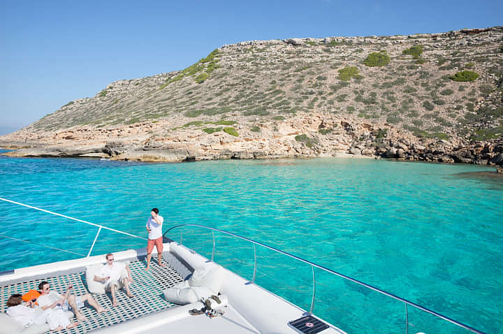 The catamaran trip includes one stop at a crystal water beach
