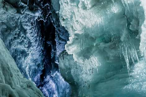 Into the Glacier Ice Cave Large Crevasse Blue Ice