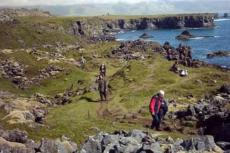 People hiking on the coast of Iceland in Snæfellsnes peninsula