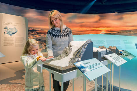 Mother and daughter enjoying the glacier exhibition at Perlan Museum