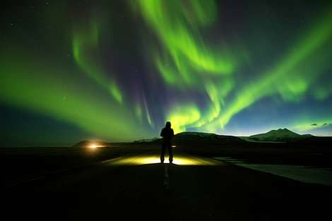 Person on Road with Northern Lights