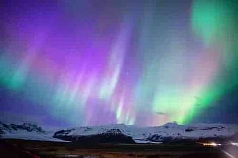 Aurora Borealis or Northern Light over mountains