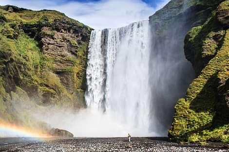 Skogarfoss Waterfall in Summer with Green plants around