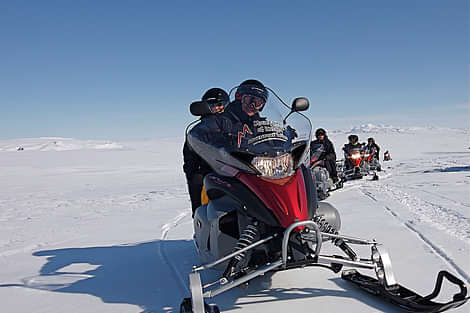 Snowmobiling on the glacier
