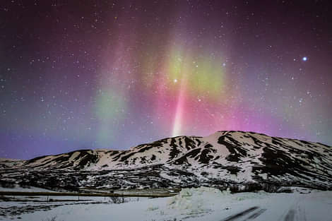Northern Lights over Mountain In Iceland