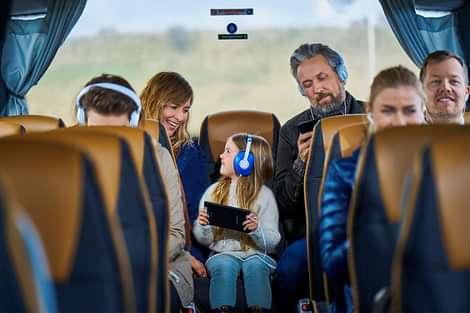 People in the reykjavik sightseeing tour bus