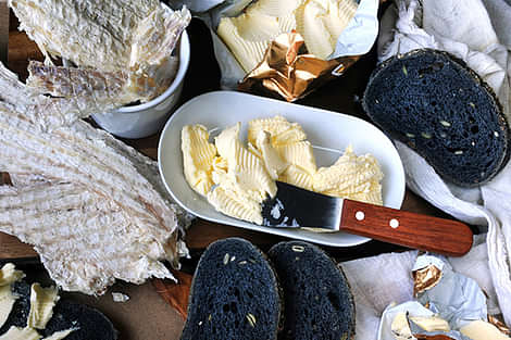 Iceland dried hard fish with charcoal bread