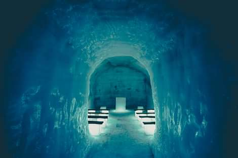 Into the Glacier Chapel in Ice Cave Tunnel